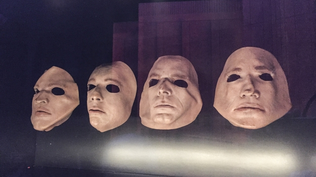 Masks of the members of Pink Floyd on display in the exhibition Pink Floyd: Their Mortal Remains at the V&A.